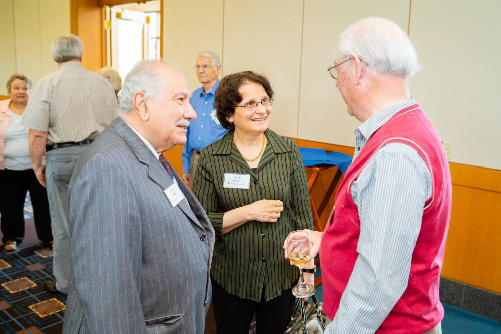 Friends chatting at the Retiree Reception.
